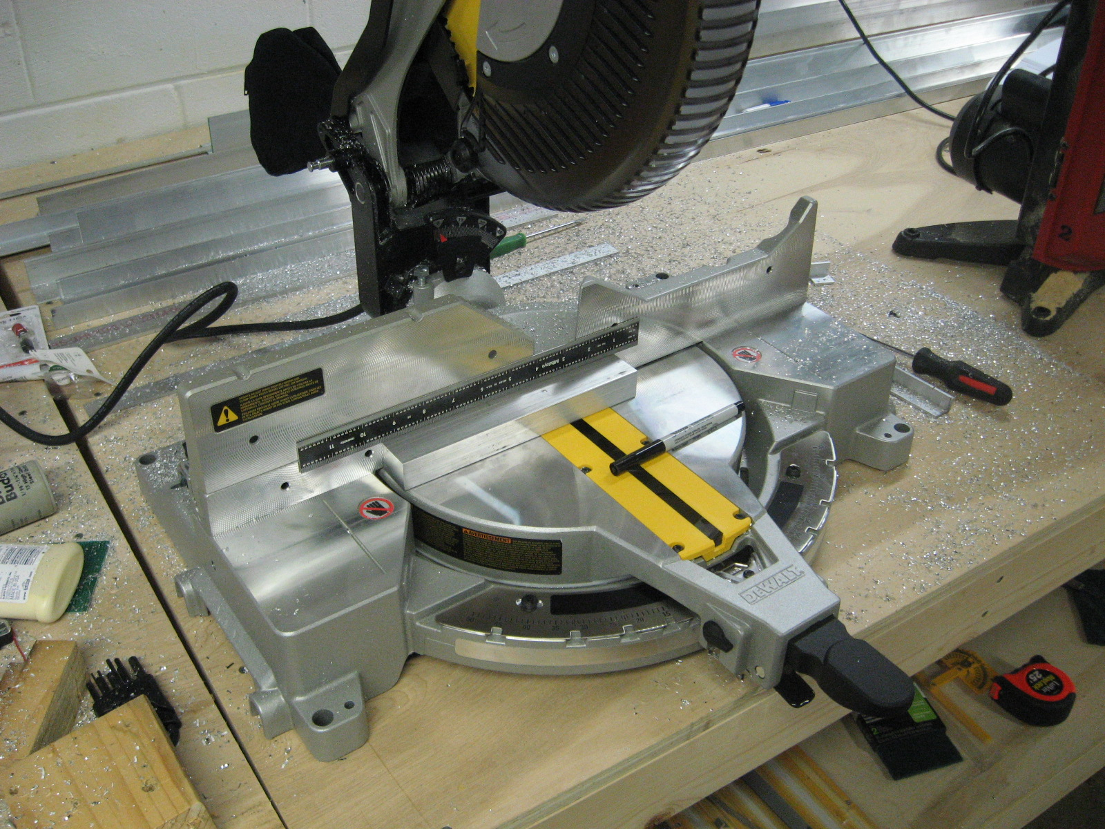 miter saw labeled. new miter saw with a block of aluminum labeled